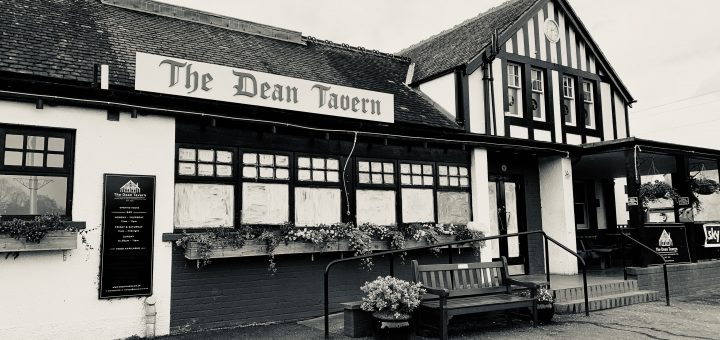 Exterior of the Dean Tavern closed with windows painted over